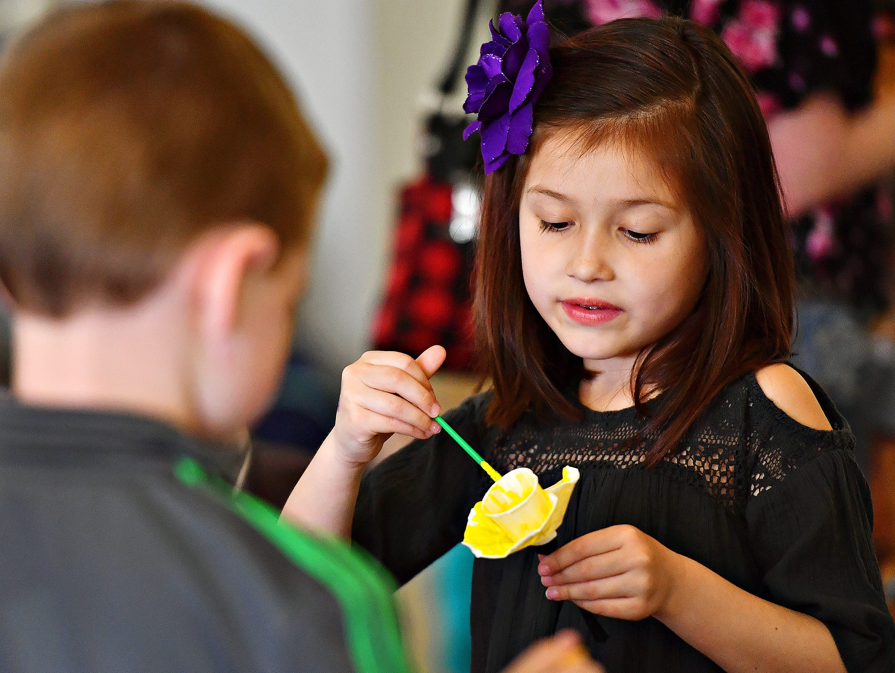 Sireyna MacNelly, 6, right, of Jackson Township, paints a daffodil with her cousin Evan Wagaman, 6, of North Codorus Township during Glatfelter Memorial Library's Annual Read-a-thon event in Spring Grove, Saturday, April 6, 2019. Dawn J. Sagert photo