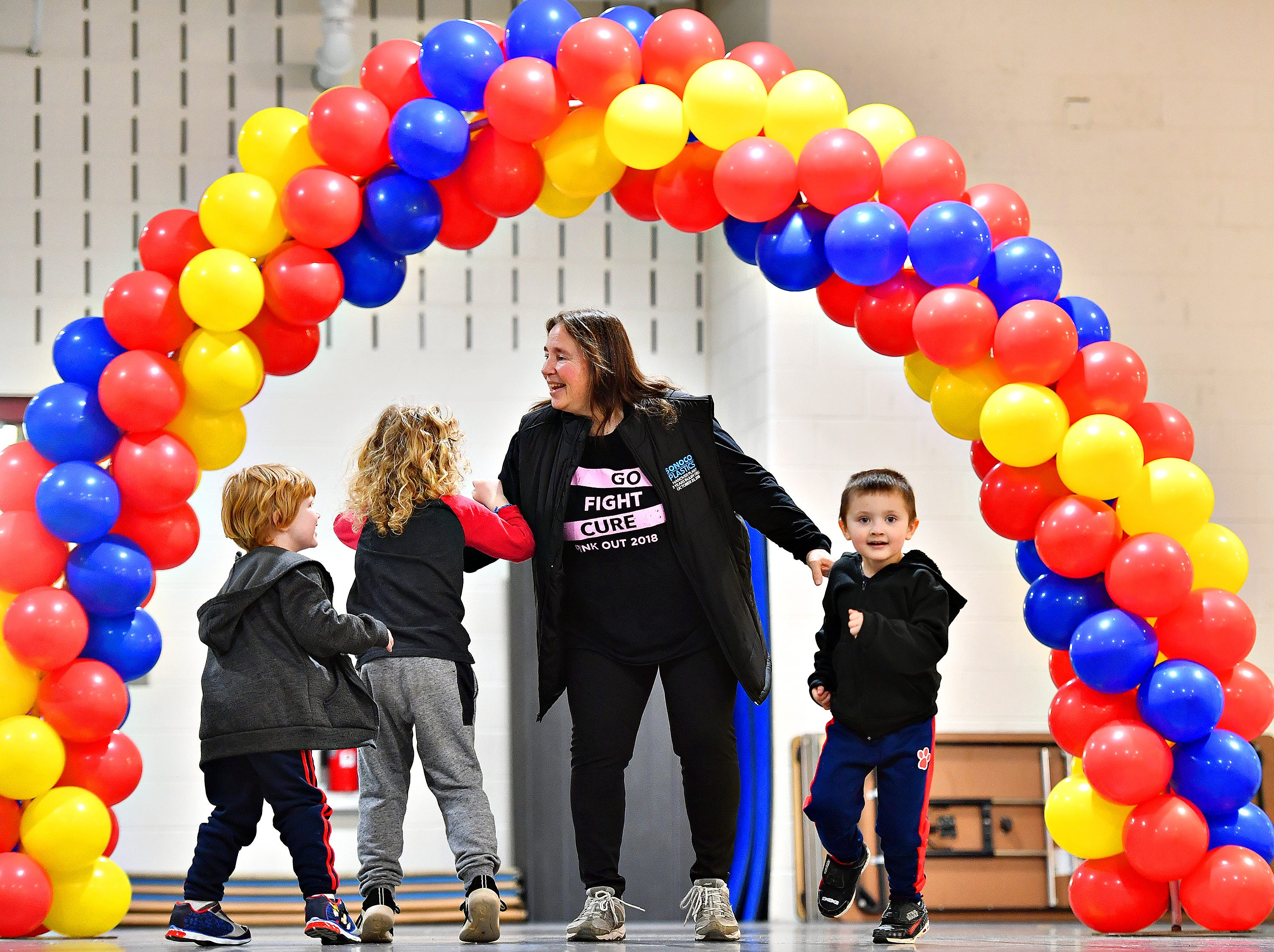 Lisa Thayer, center, of Hanover, energetically runs the track with her three grandchildren who live in Red Lion, during the 2019 Walk for Autism & Autism Expo at Central York High School in Springettsbury Township, Saturday, April 6, 2019. Dawn J. Sagert photo
