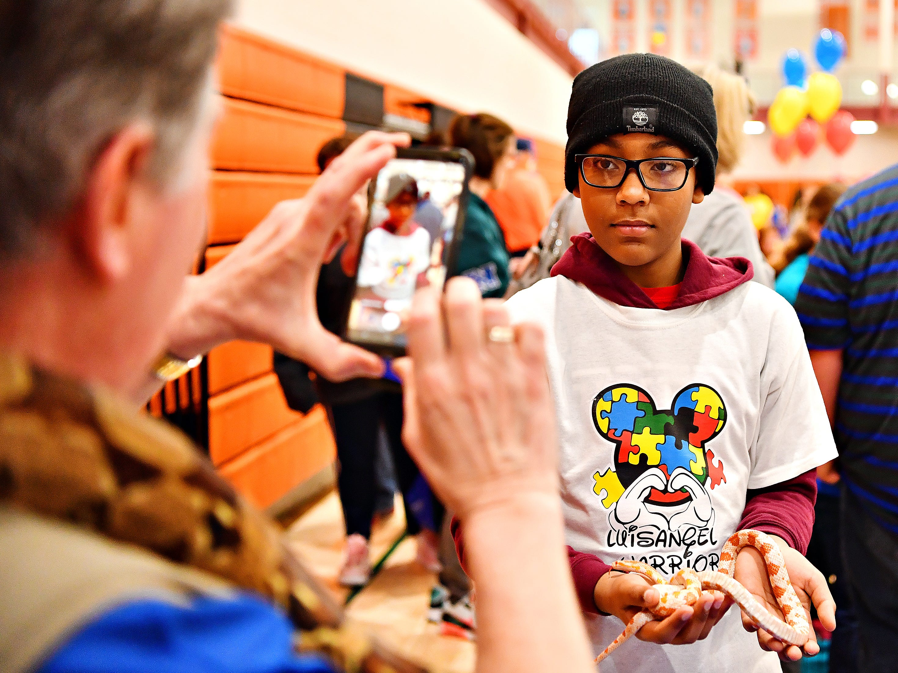 Critter Connections, based in York Township, offers a chance to hold a variety of reptiles and a tarantula during the 2019 Walk for Autism & Autism Expo at Central York High School in Springettsbury Township, Saturday, April 6, 2019. Dawn J. Sagert photo