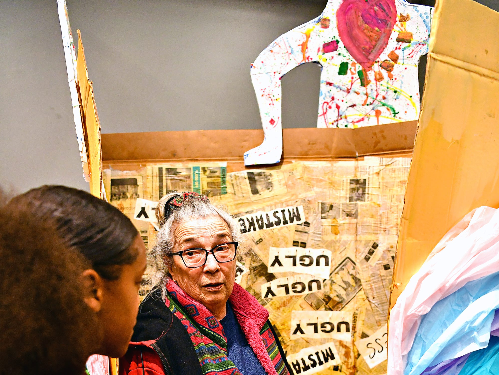 "Edgar Fahs Smith STEAM Academy sixth-grader Mikya Holley, 11, left, explains her group project, ""The Bully Box"" to Nancy Sieling, of York Township, during the school's Conflict & Change!! exhibit at Marketview Arts during First Friday in York City, Friday, April 5, 2019. Dawn J. Sagert photo"