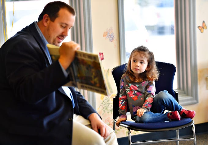 "Emma Leonard, 3, of North Codorus Township, looks on as Pennsylvania Rep. Seth Grove reads, ""Where the Wild Things Are,"" by Maurice Sendak, during Glatfelter Memorial Library's Annual Read-a-thon event in Spring Grove, Saturday, April 6, 2019. Dawn J. Sagert photo"