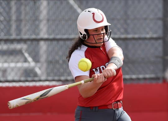 Wooster's Abigael Marines takes a swing at the ball during a game against the Raiders on Thursday April 4, 2019