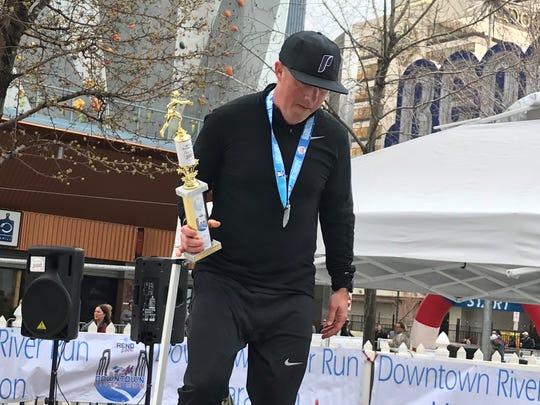 Kris Rollin was second overall in the half-marathon in 1:23.36.8