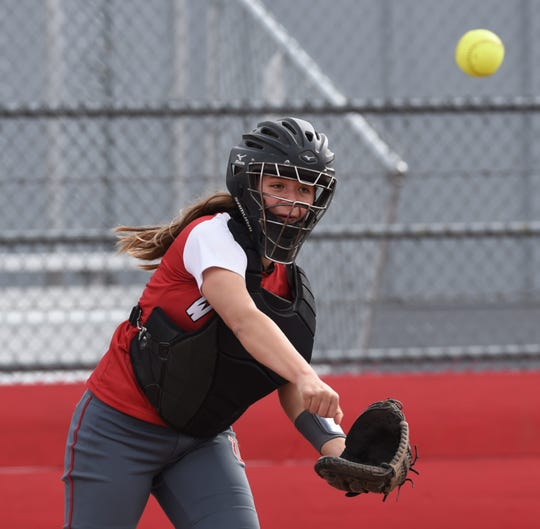 Wooster's Maddy Hunden attemps to get a runner at first base during a home game against the Raiders on Thursday April 4, 2019