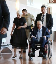 Former U.S. senator Harry Reid and his wife Landra Gould leave the courtroom after attending Reid's civil trial at the Regional Justice Center on Friday, April 5, 2019, in Las Vegas. Reid sued the makers of an exercise band after injuring his eye. (Bizuayehu Tesfaye/Las Vegas Review-Journal via AP)