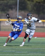 Webster Schroeder 's Cole Bollin tries to get by Honeoye Falls-Lima's Devin Rogers.