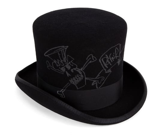 This photo provided by Julien's Auctions shows a signed top hat that belongs to  Guns N' Roses guitarist Slash.  The former wife of Slash is selling off exotic and erotic items, including the signed top hat,  from their 14 years of marriage. Julien's Auctions on Thursday, April 3, 2019,  announced the collection from Slash and Perla Hudson's Beverly Hills estate will be part of next month's Music Icons auction.