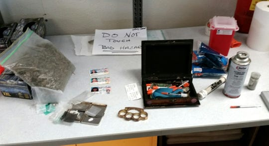A Siskiyou County sheriff's deputy making a traffic stop seized contraband including drugs, brass knuckles, a portable butane honey oil lab and drug paraphernalia.