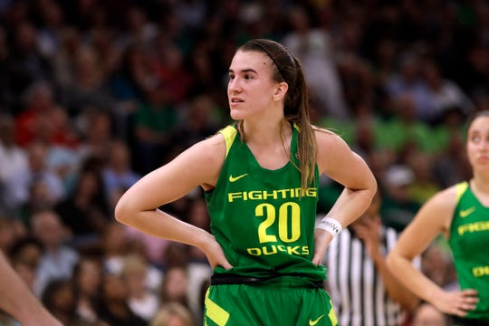 Oregon guard Sabrina Ionescu (20) looks around the court, during the second half of a women's Final Four NCAA college basketball semifinal tournament game against Baylor, Friday, April 5, 2019, in Tampa, Fla.