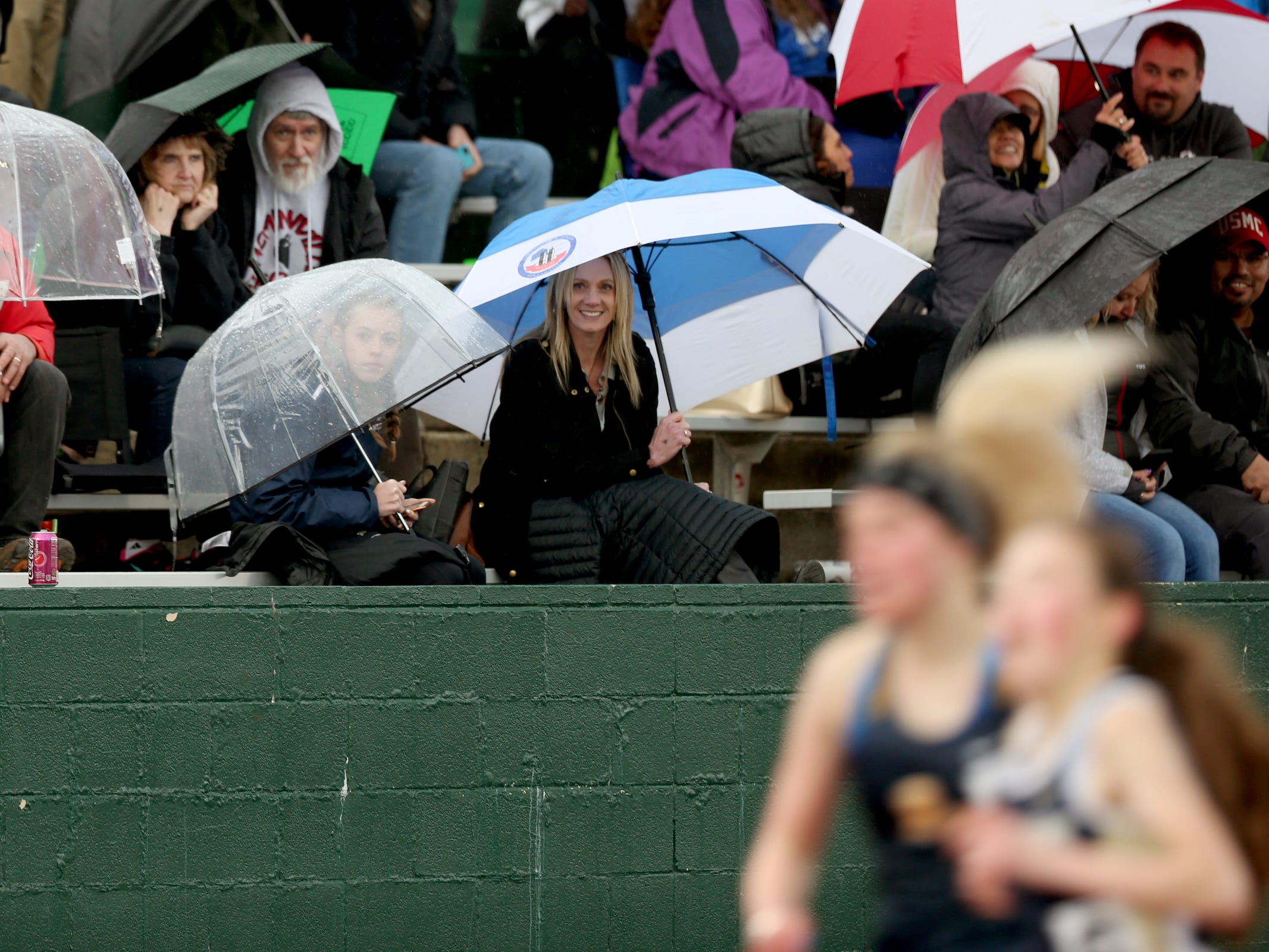 Fans watch the girls 1500 meter race during the Titan Track Classic high school track and field meet at West Salem High School on April 5, 2019.