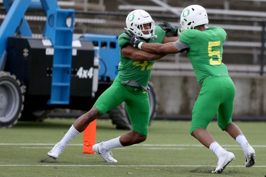 Gus Cumberlander (45) and Kayvon Thibodeaux (5) battle during the Oregon Ducks spring football practice and scrimmage at Hillsboro Stadium on April 6, 2019.