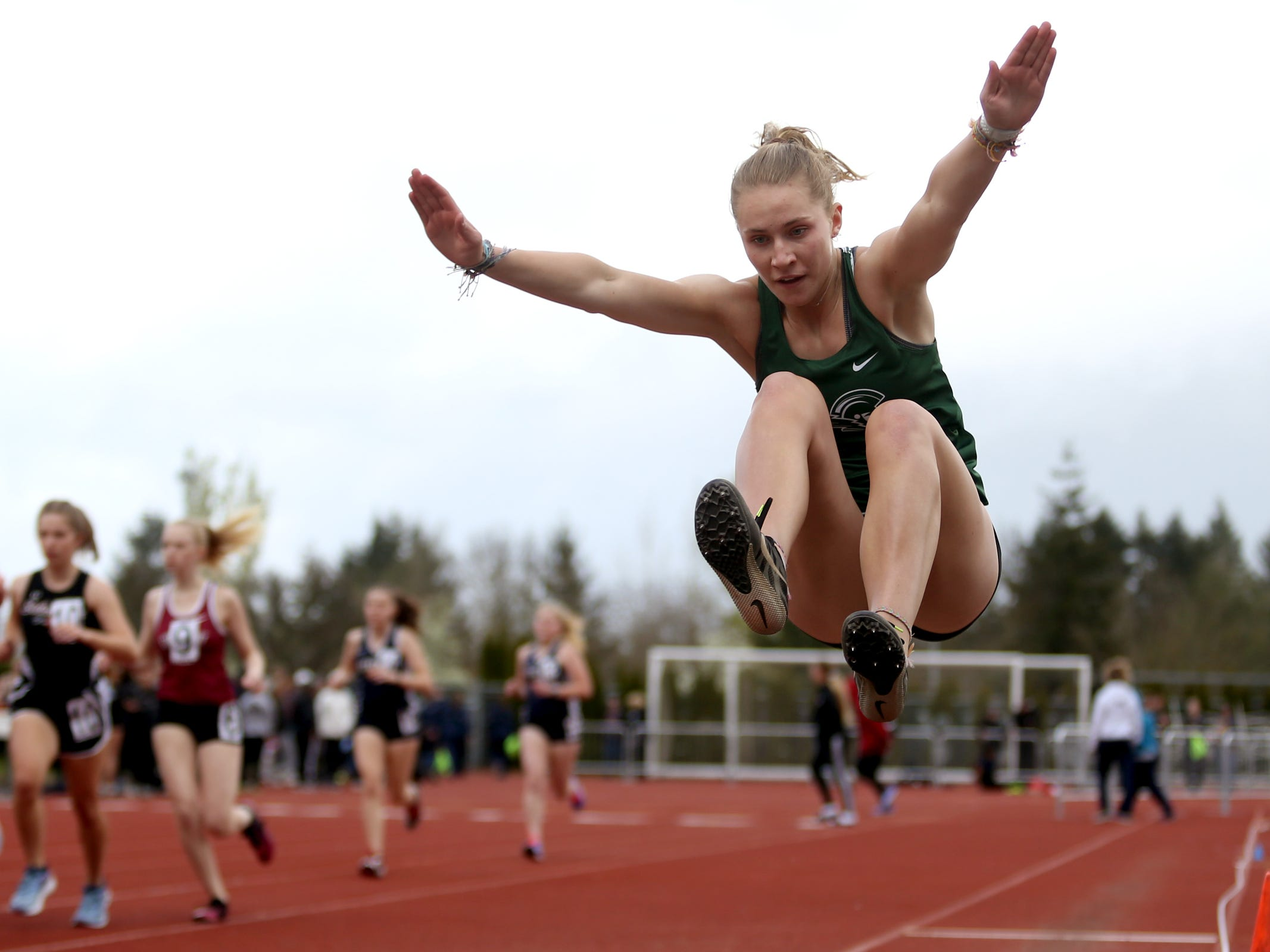 West Salem's Sarah Rice competes in the girls long jump during the Titan Track Classic high school track and field meet at West Salem High School on April 5, 2019.