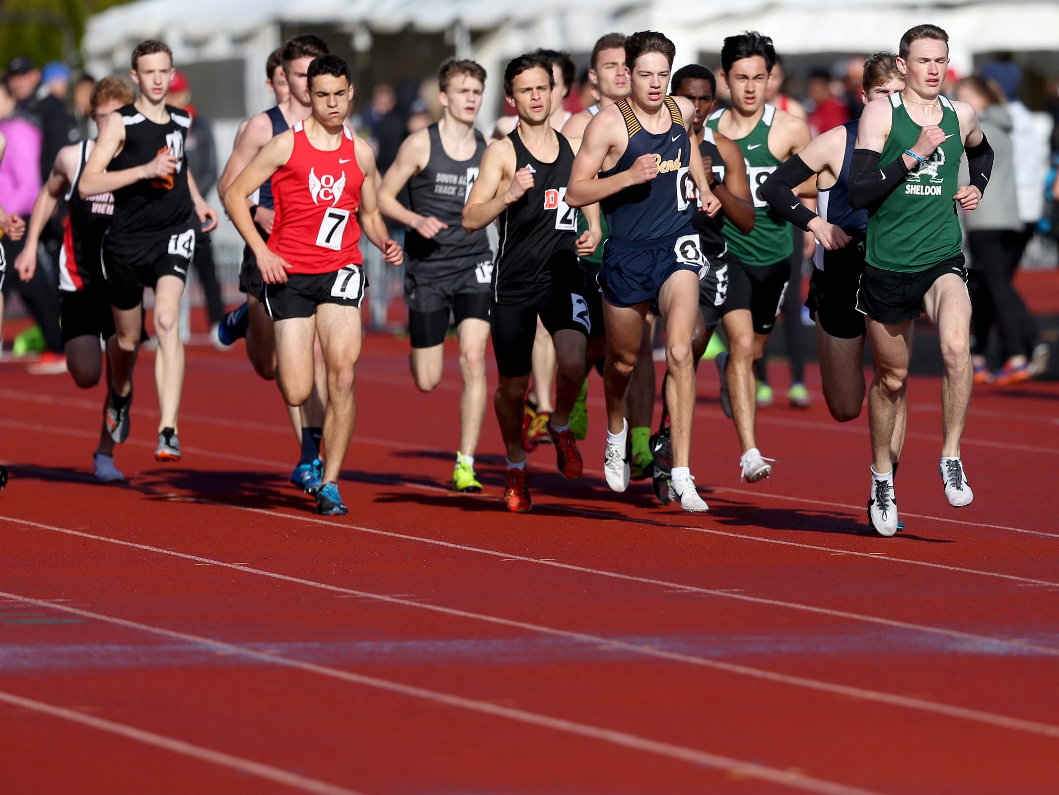 The boys 1500 meter run during the Titan Track Classic high school track and field meet at West Salem High School on April 5, 2019.