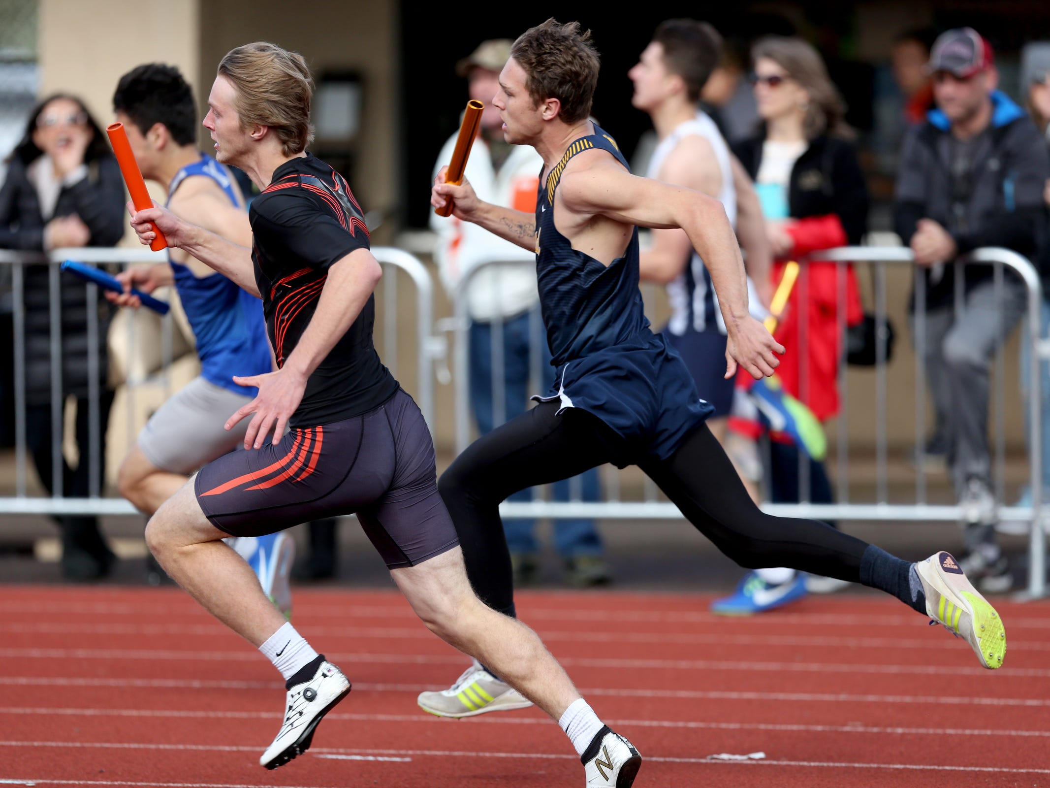 Competitors in the boys 4x100 meter relay race during the Titan Track Classic high school track and field meet at West Salem High School on April 5, 2019.