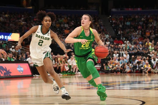 Oregon Ducks guard Sabrina Ionescu (20) dribbles the ball past Baylor Lady Bears guard DiDi Richards (2) during the first half in the semifinals of the women's Final Four of the 2019 NCAA Tournament at Amalie Arena.