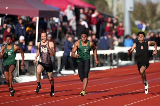 From left, West Salem's Stanley Green, North Bend's Jonathan Chilcote, West Salem's Jamal McMurrin and Dallas' Malaki Connella compete in the boys 100 meter dash during the Titan Track Classic high school track and field meet at West Salem High School on April 5, 2019.