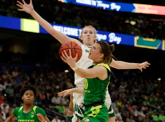 Oregon guard Sabrina Ionescu (20) drives to the basket as Baylor forward Lauren Cox (15), defends during a Final Four semifinal of the NCAA women's college basketball tournament Friday, April 5, 2019, in Tampa, Fla.