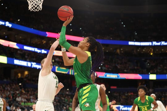 Oregon Ducks forward Satou Sabally (0) shoots the ball over Baylor Lady Bears forward Lauren Cox (15) during the first half in the semifinals of the women's Final Four of the 2019 NCAA Tournament at Amalie Arena.