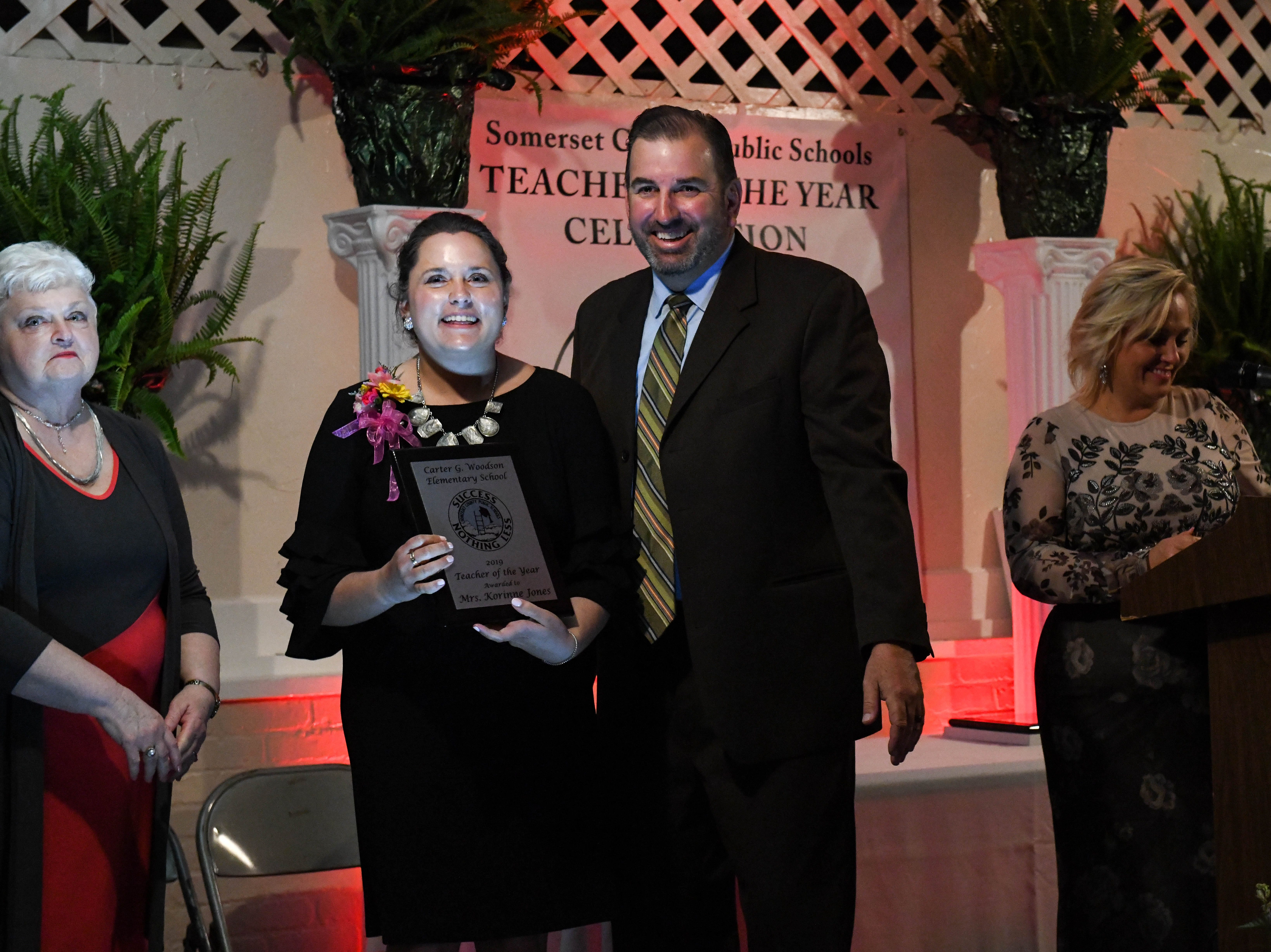 Woodson Elementary teacher Korinne Jones receives a plaque for her Somerset County teacher of the year nominee at the banquet on Friday, April 5, 2019.