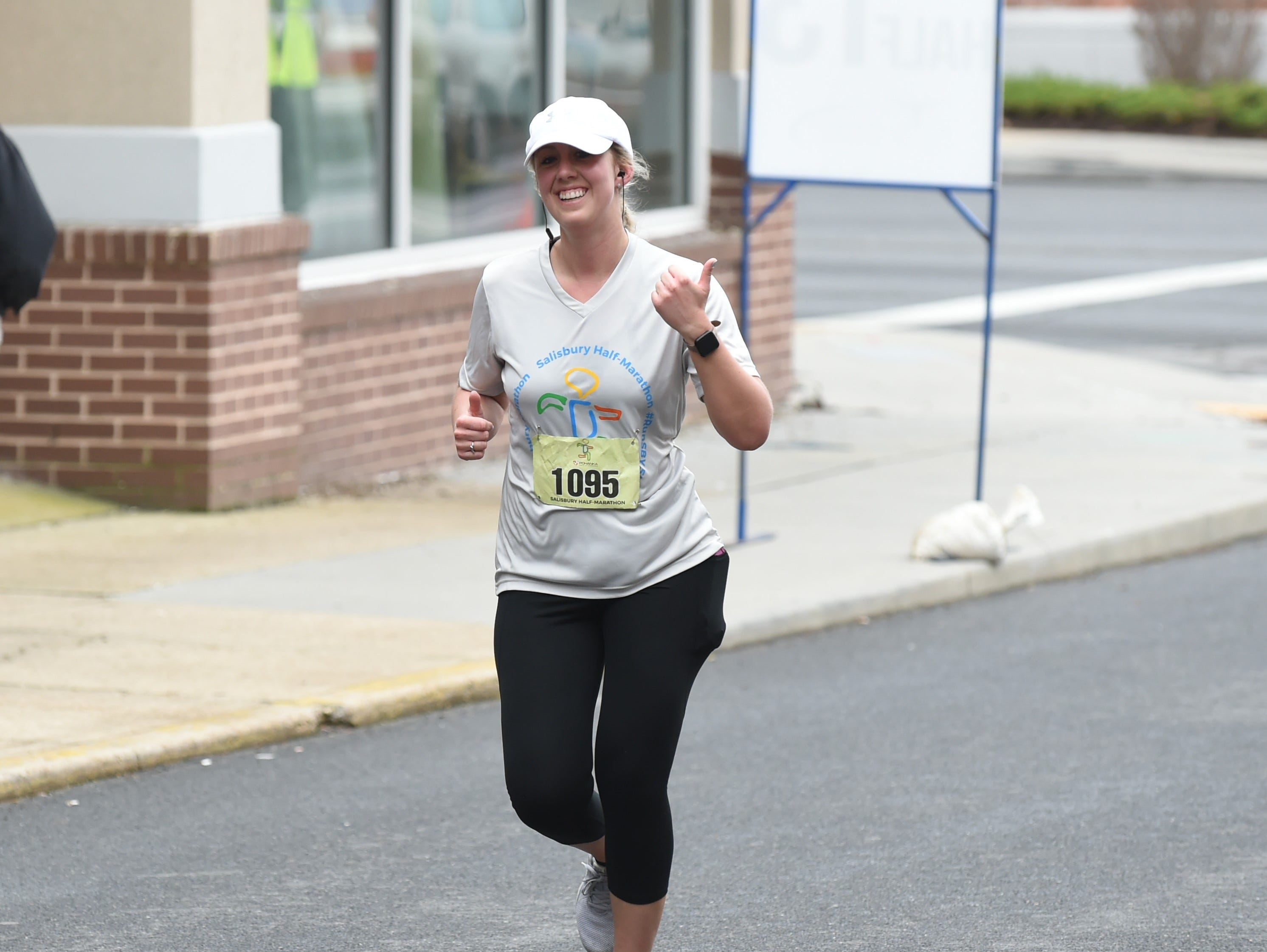 Laura Jackson gives a thumbs up as she finishes the half marathon at the 2nd Salisbury Marathon/ Half Marathon/ 5k on Saturday, April 6, 2019.