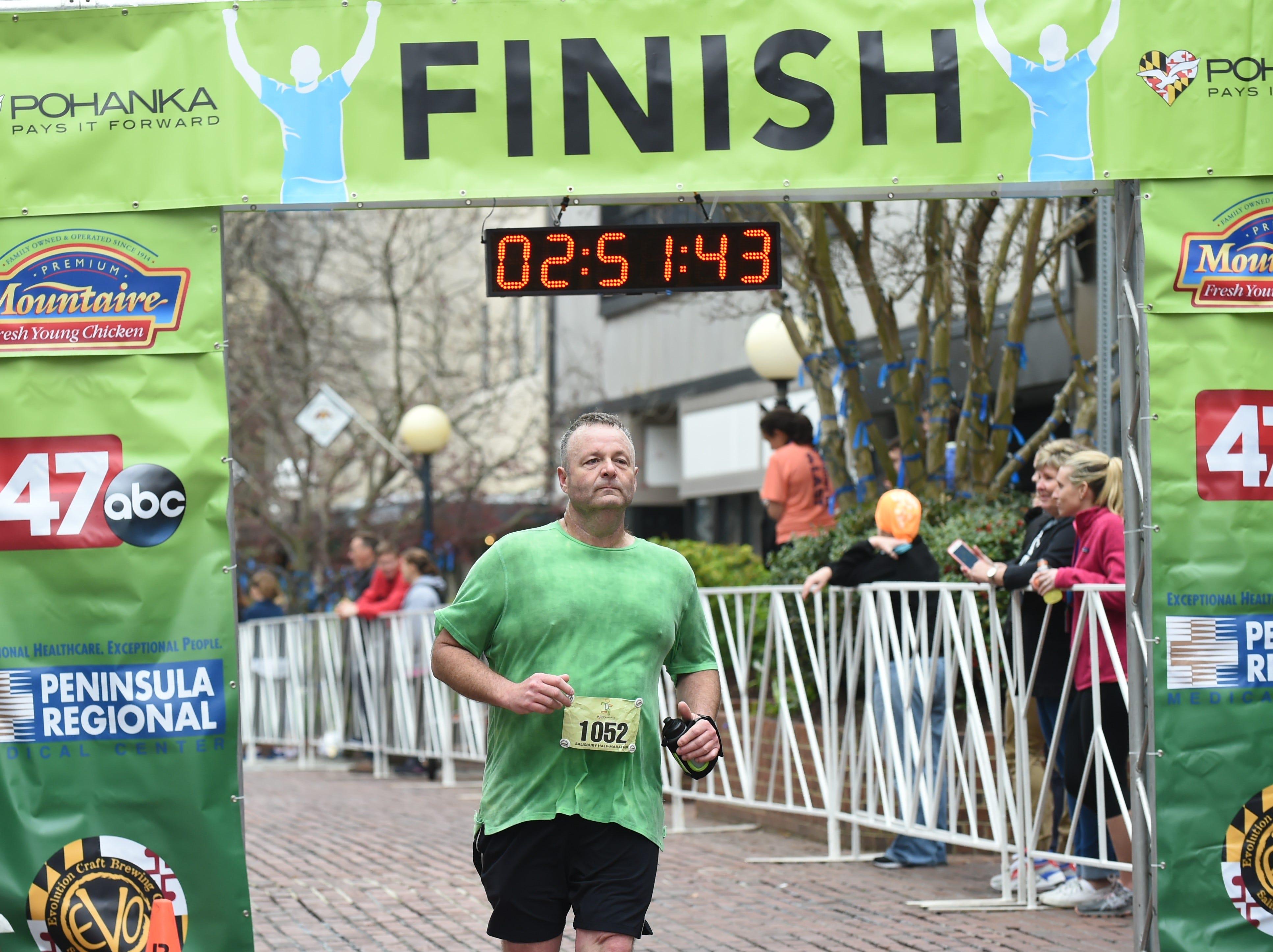 Joseph Andrews crosses the finish line after running in the 2nd Salisbury Marathon/ Half Marathon/ 5k.
