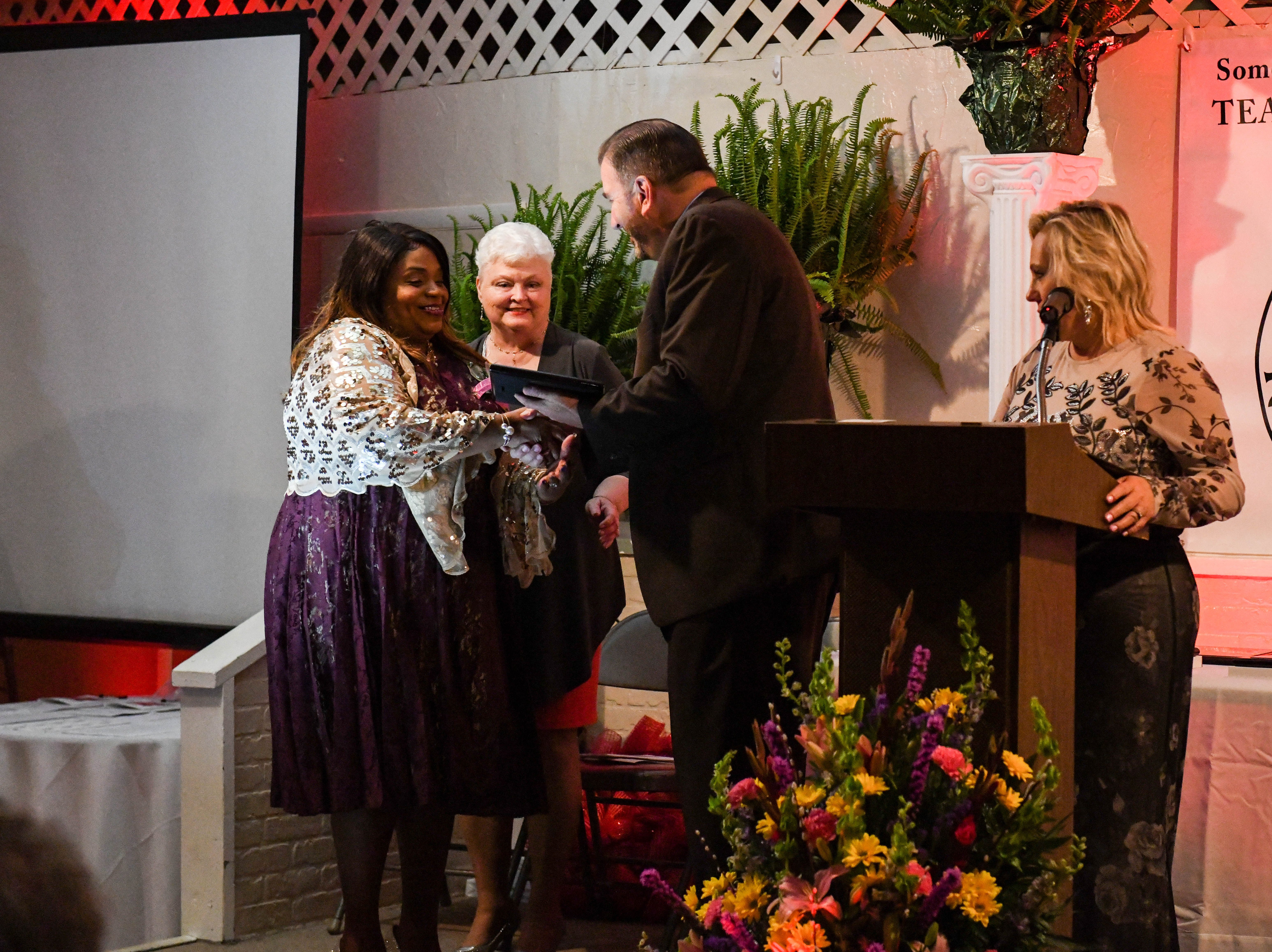 Andranette Holden-Hall, Somerset County Secondary School teacher of the year, receives a plaque at the banquet on Friday, April 5, 2019.