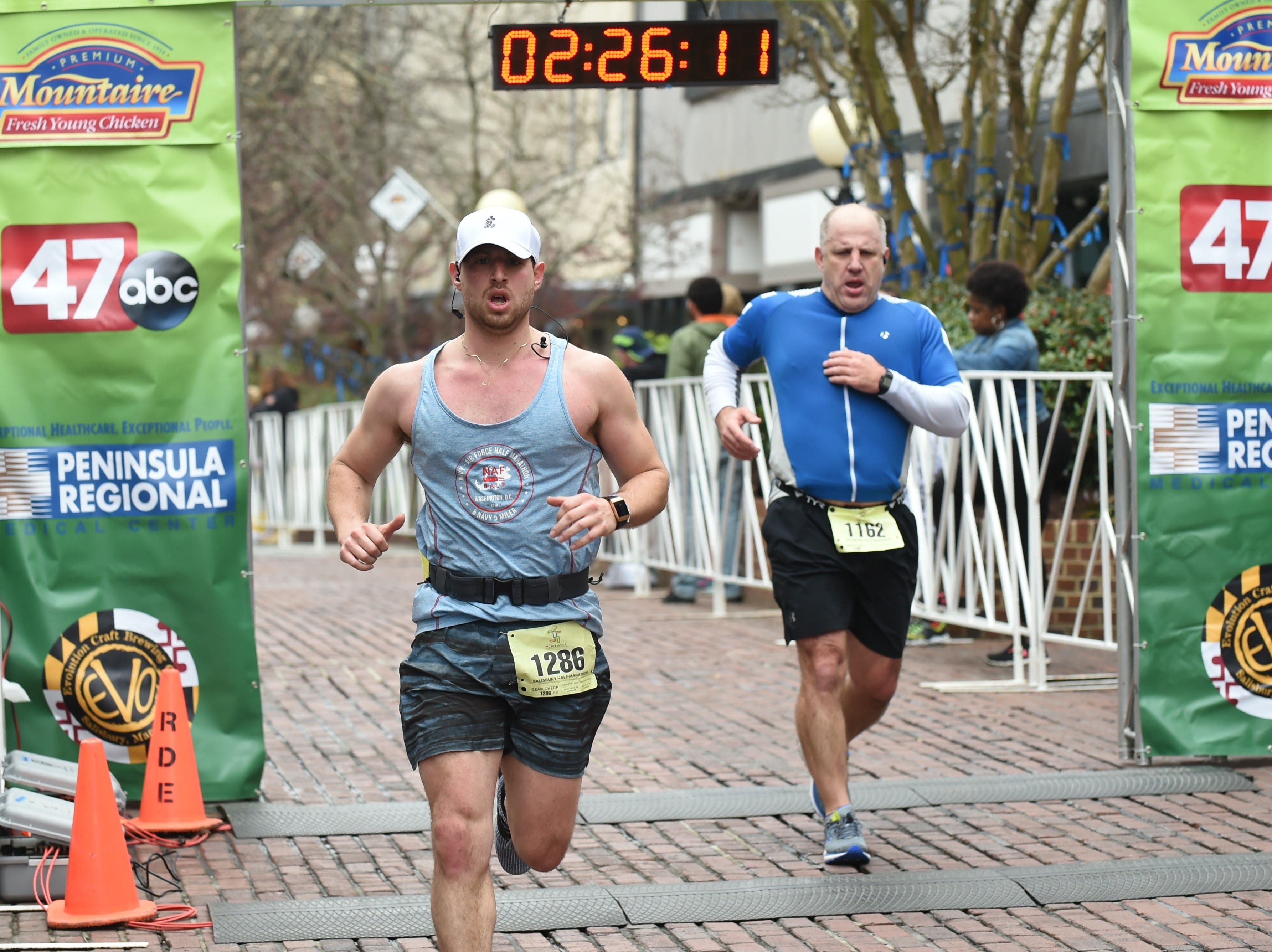 Lee Brill (left) and Rich Hernandez cross the finish line at the 2nd Salisbury Marathon/ Half Marathon/ 5k on Saturday, April 6, 2019.