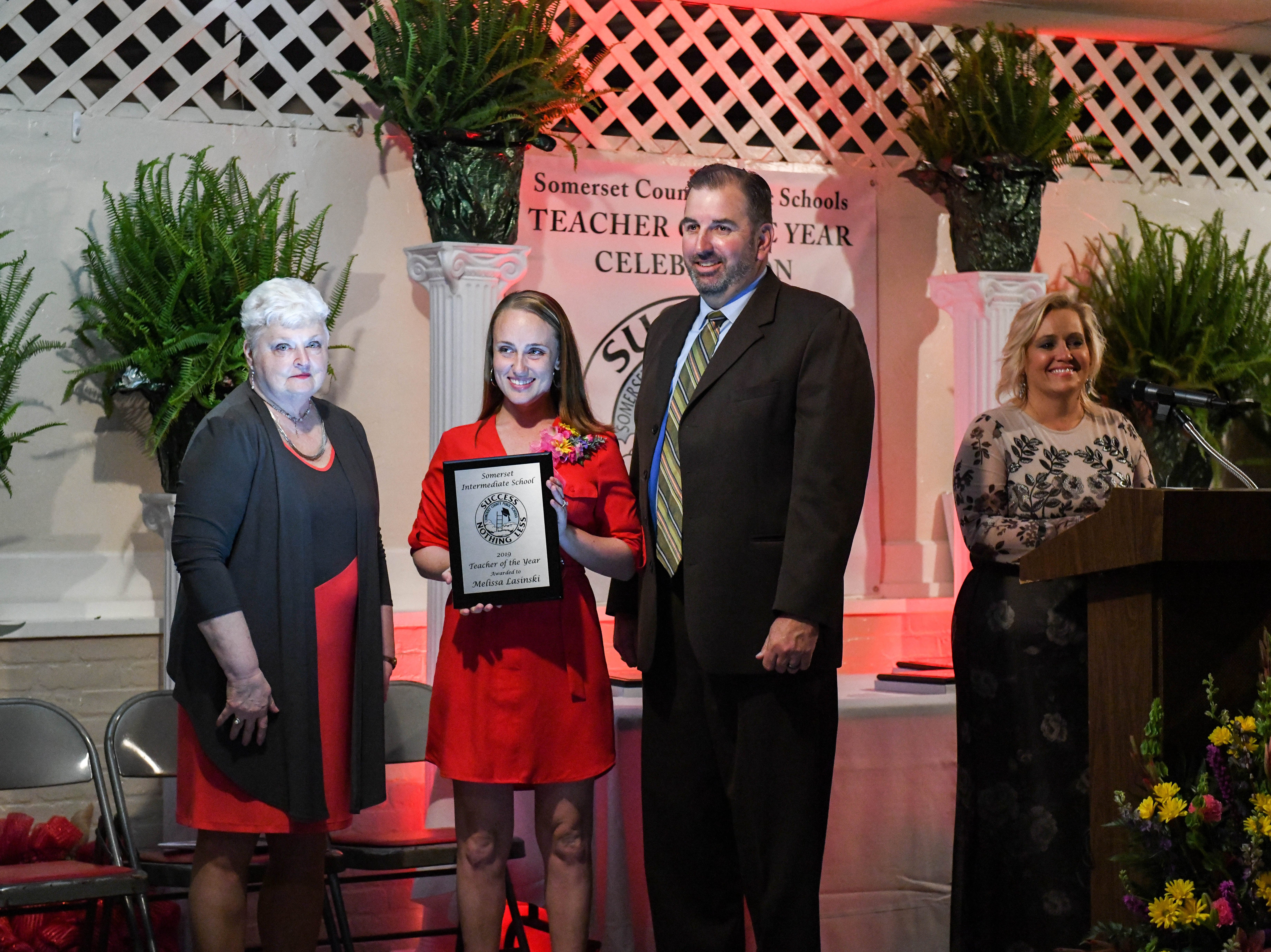 Somerset Intermediate teacher Melissa Lasinski receives a plaque for her teacher of the year nomination at the banquet on Friday, April 5, 2019.