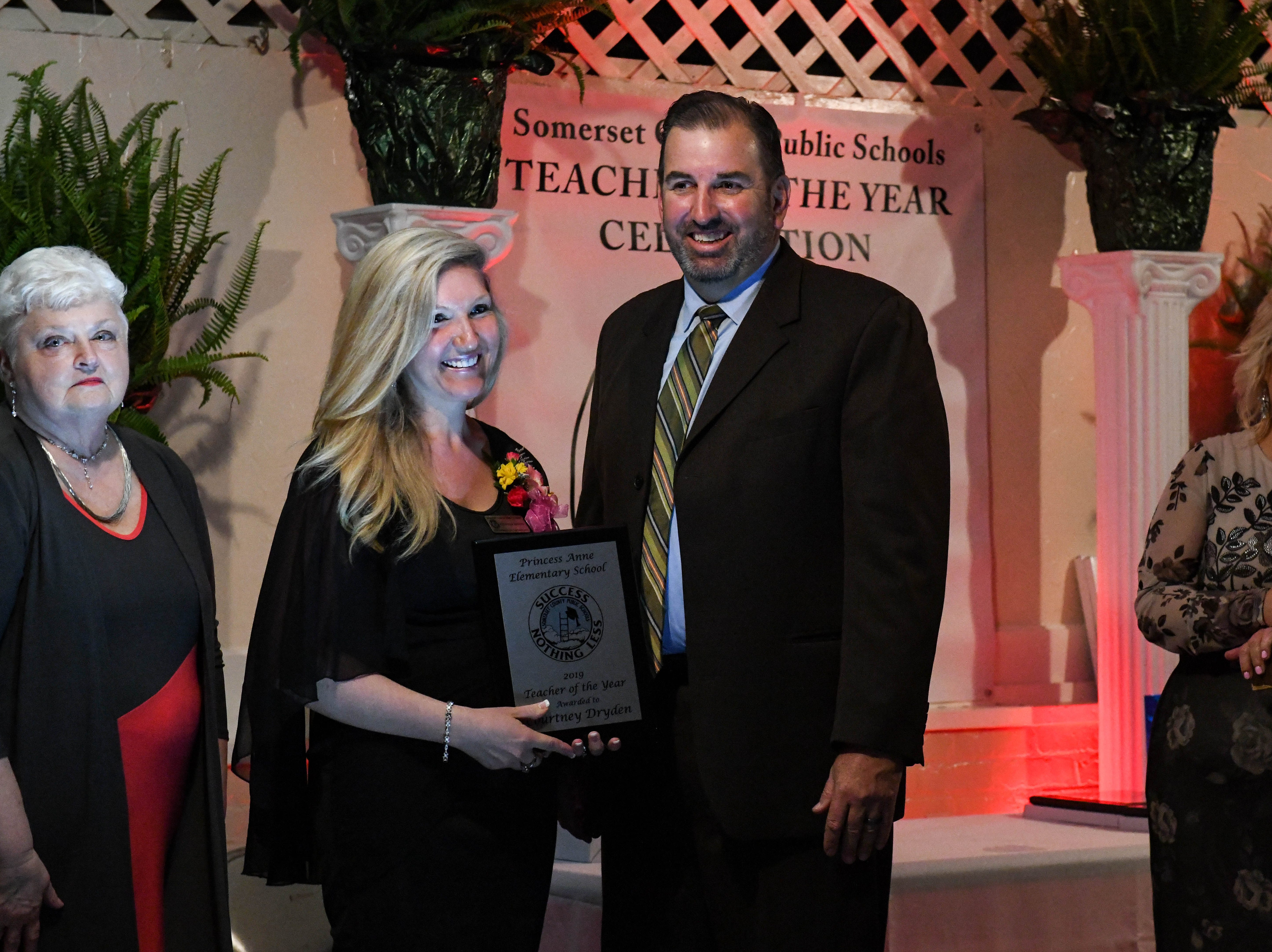 Princess Anne Elementary teacher Courtney Dryden receives a plaque for her teacher of the year nomination at the banquet on Friday, April 5, 2019.