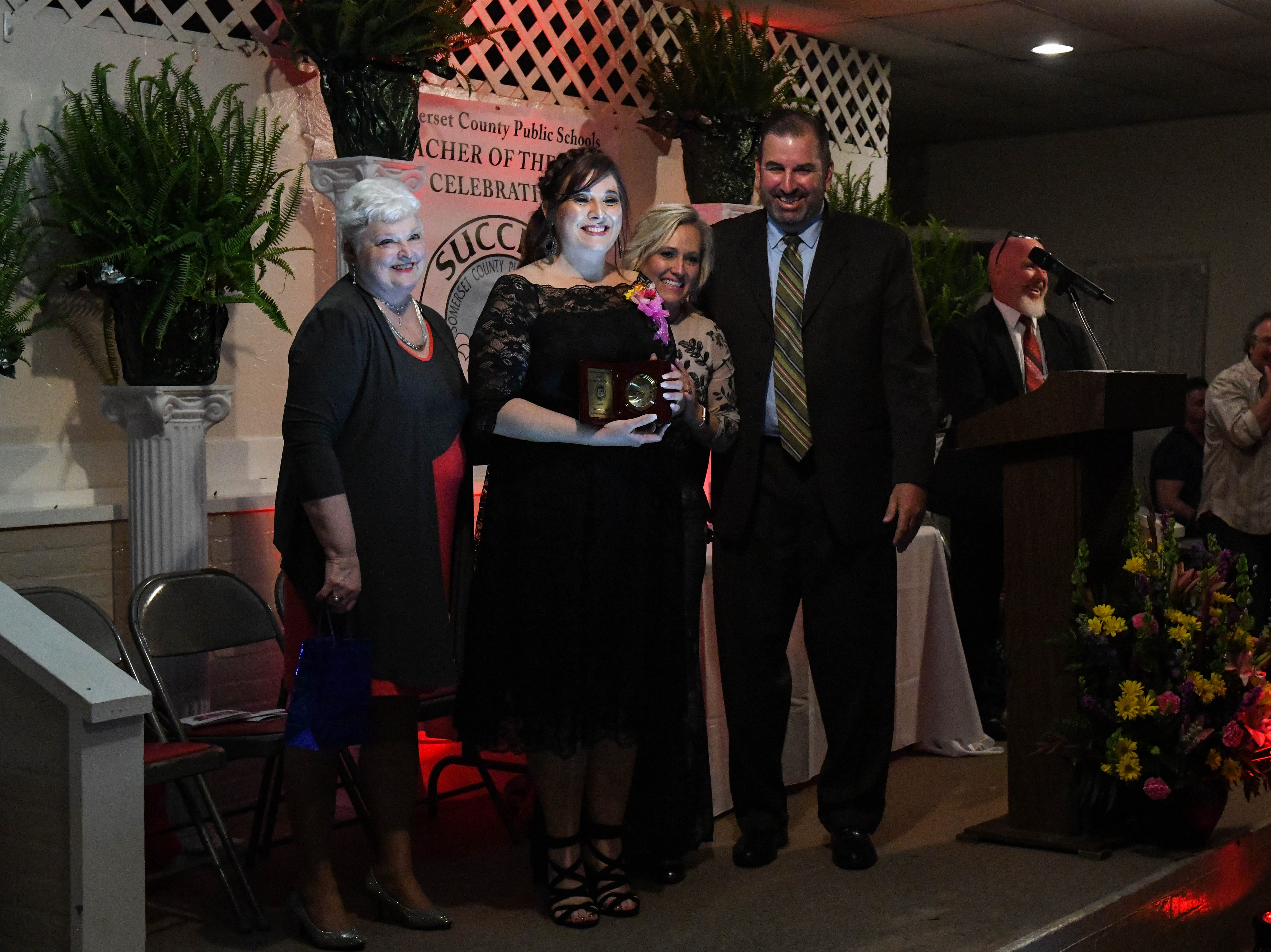 Christina South, Deal Island Elementary School teacher, receives the Somerset County teacher of the year award at the banquet on Friday, April 5, 2019.