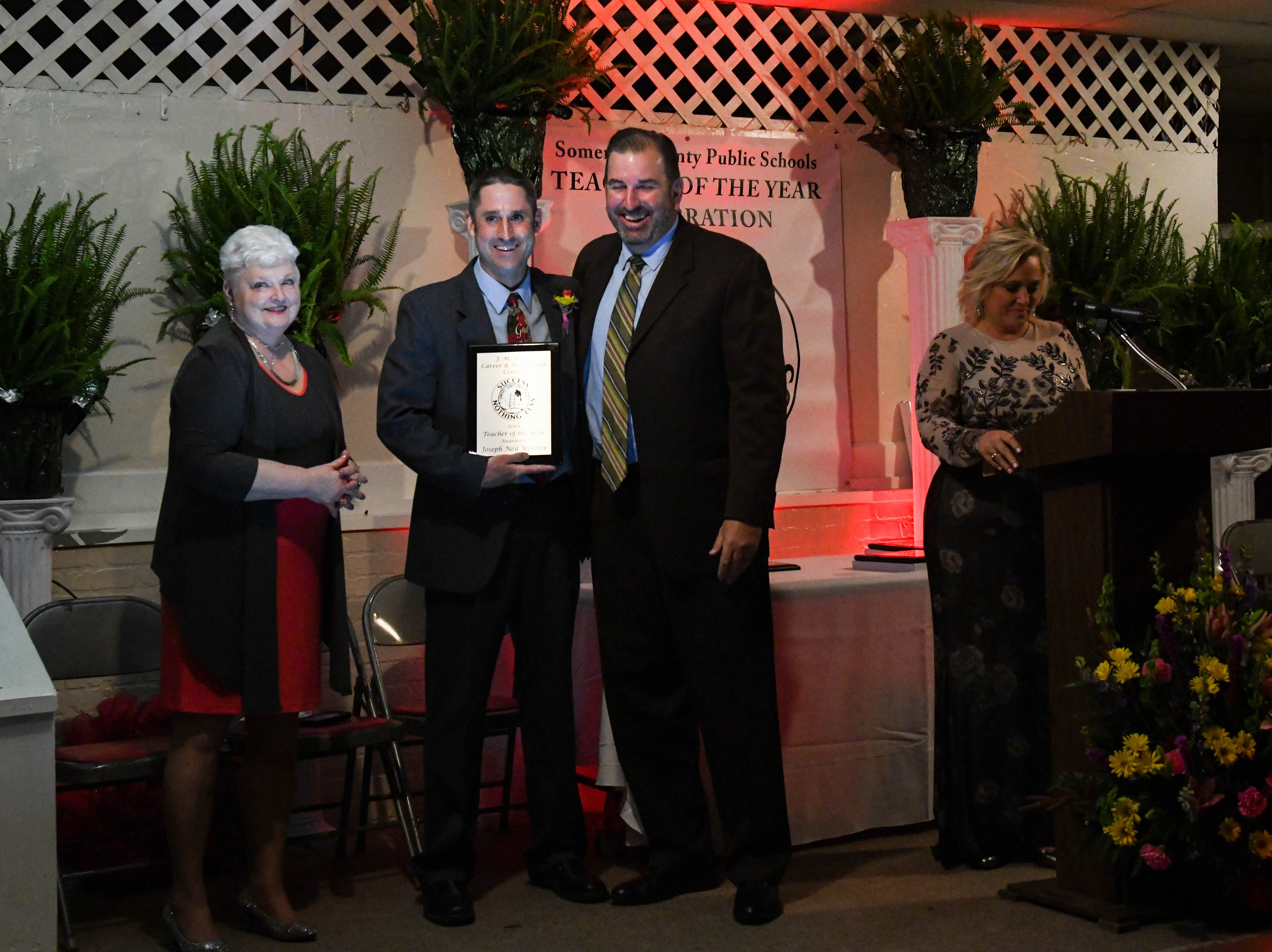 Tawes Technology teacher Joseph Webster receives a plaque for his teacher of the year nomination at the banquet on Friday, April 5, 2019.