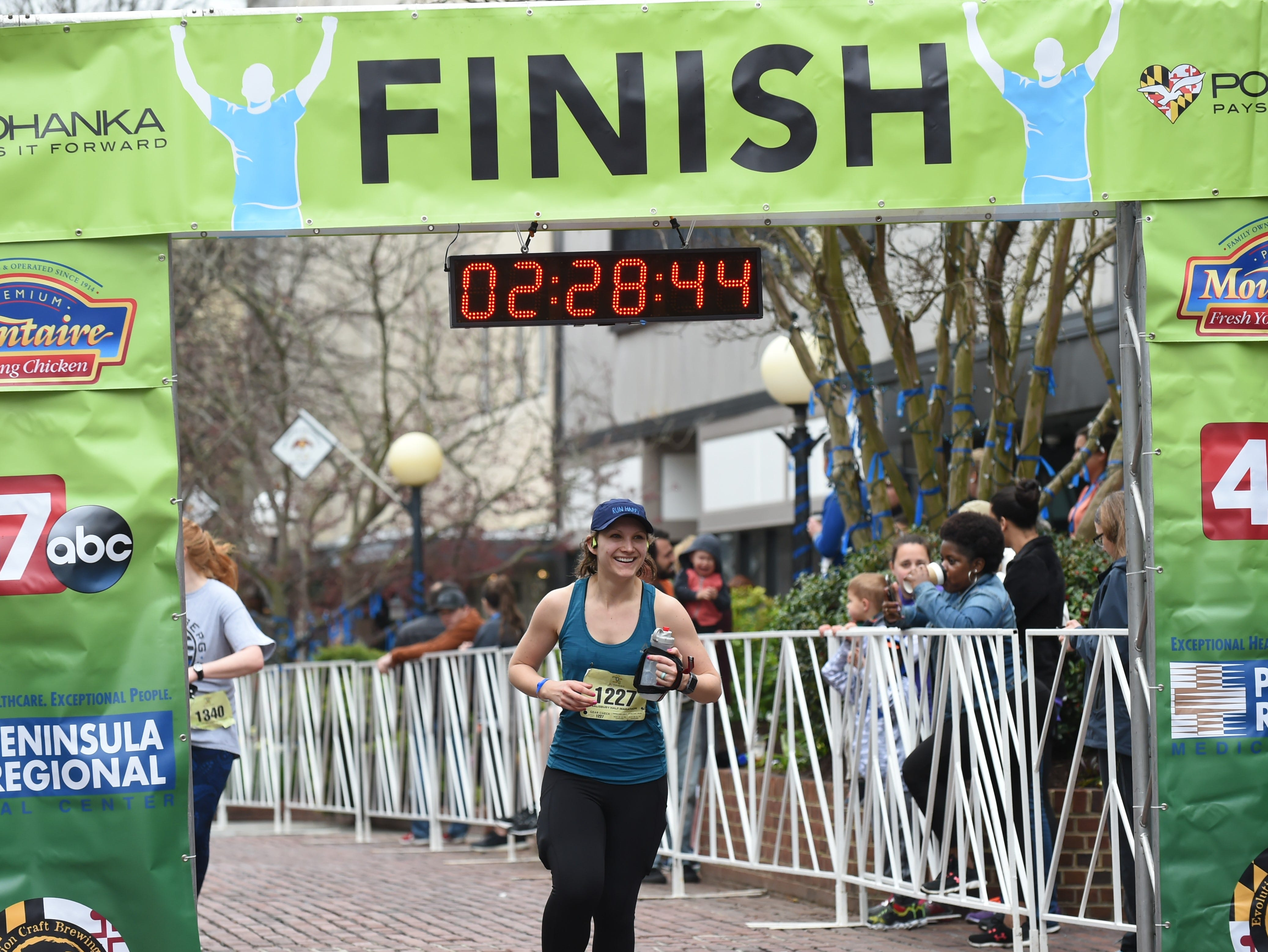 Stephanie Rush crosses the finish line after running in the 2nd Salisbury Marathon/ Half Marathon/ 5k on Saturday, April 6, 2019.