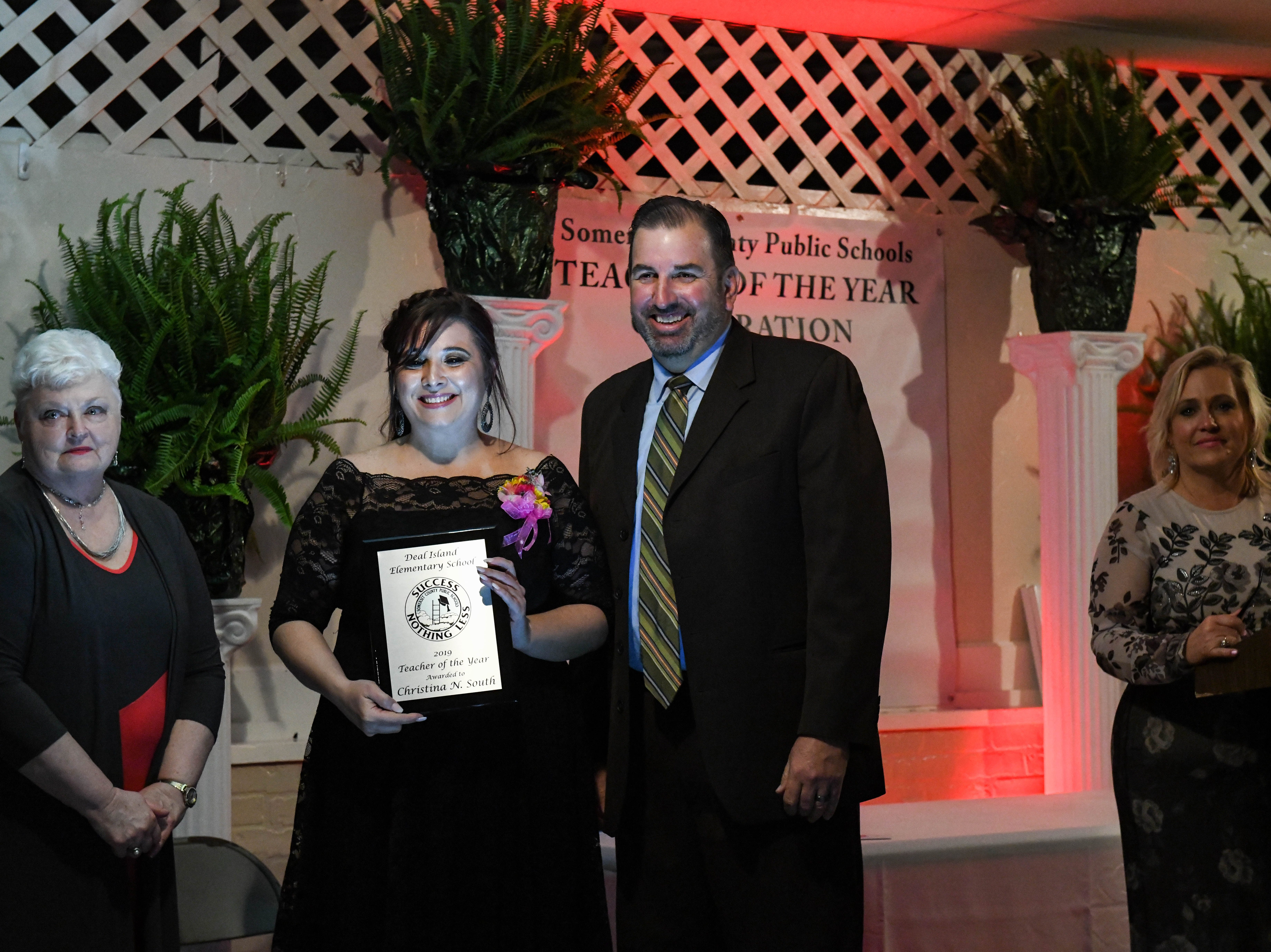 Deal Island Elementary teacher Christina South receives a plaque for her Somerset County teacher of the year award at the banquet on Friday, April 5, 2019.