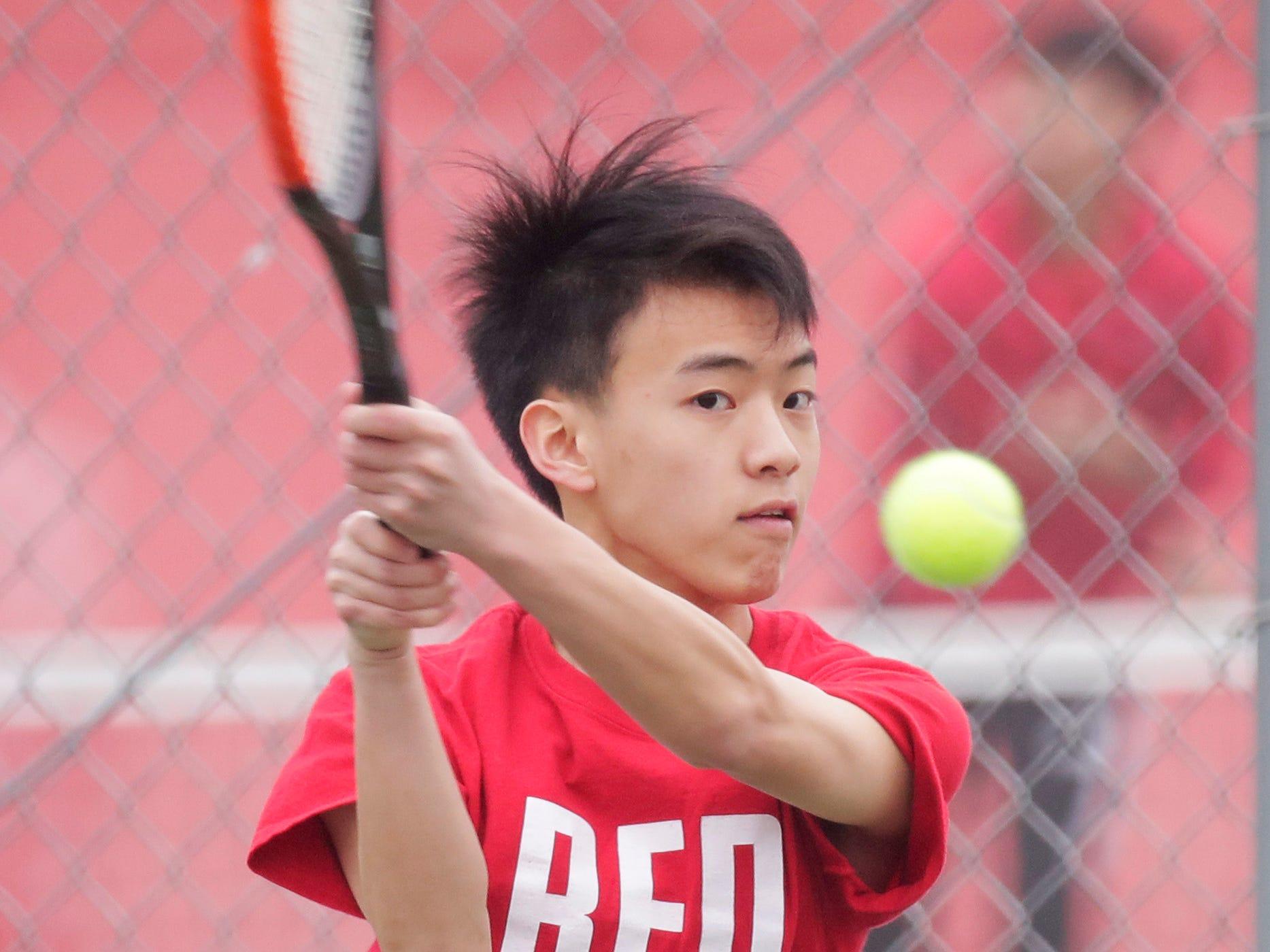 Sheboygan South's Kongmeng Yang returns a serve from Port Washiington during No. 1 doubles action, Saturday, April 6, 2019, in Sheboygan, Wis.