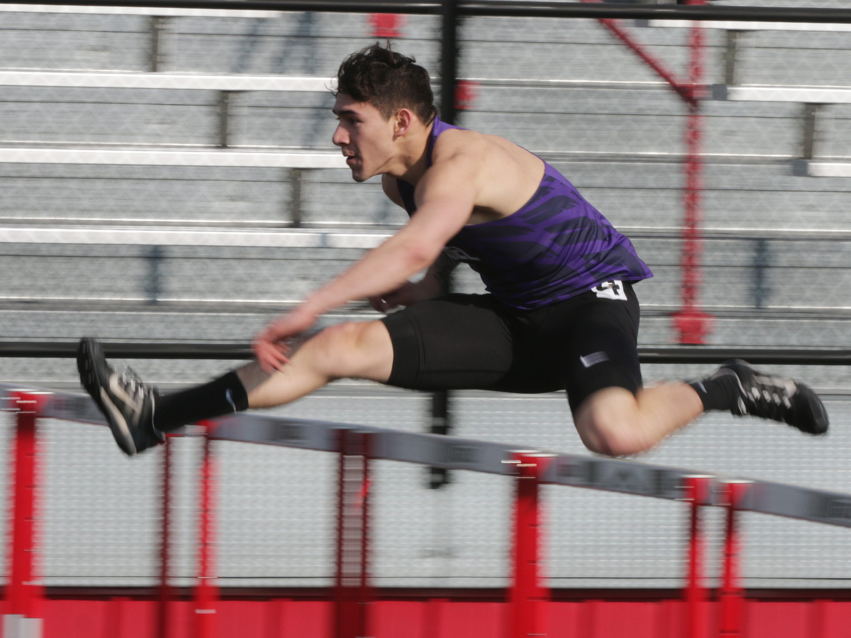 Kiel's Elio Alzate flies over the hurdles during the 110 high hurdles event at the Flying Dutchmen Invite, Friday, April 5, 2019, in Oostburg, Wis.