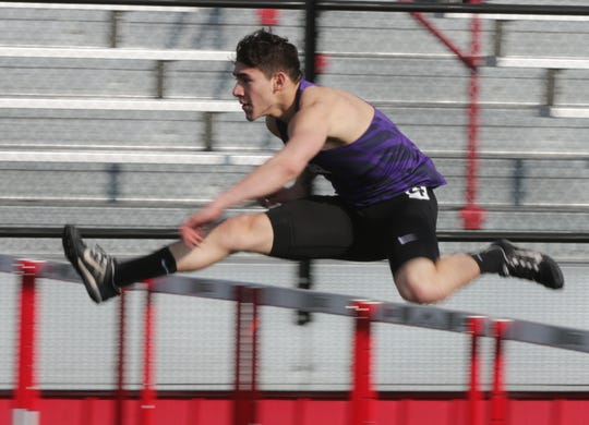 Kiel's Elio Alzate flies over the hurdles during the 110-meter high hurdles event at the Flying Dutchmen Invite on Friday in Oostburg.