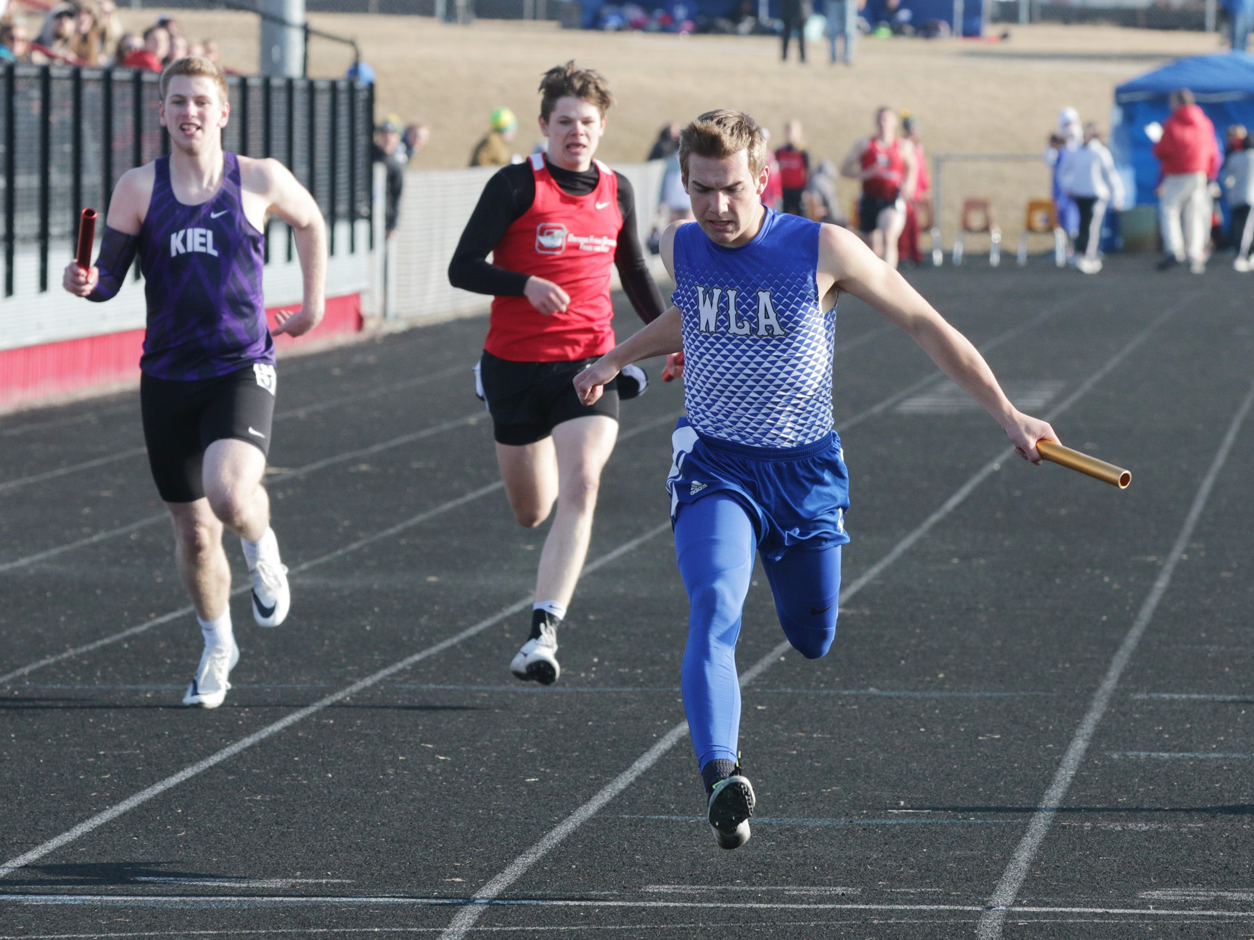 Winnebago Lutheran's Donovan Schwartz stretches at the finish line in the 4 x 200 meter relay at the Flying Dutchmen Invite, Friday, April 5, 2019, in Oostburg, Wis.