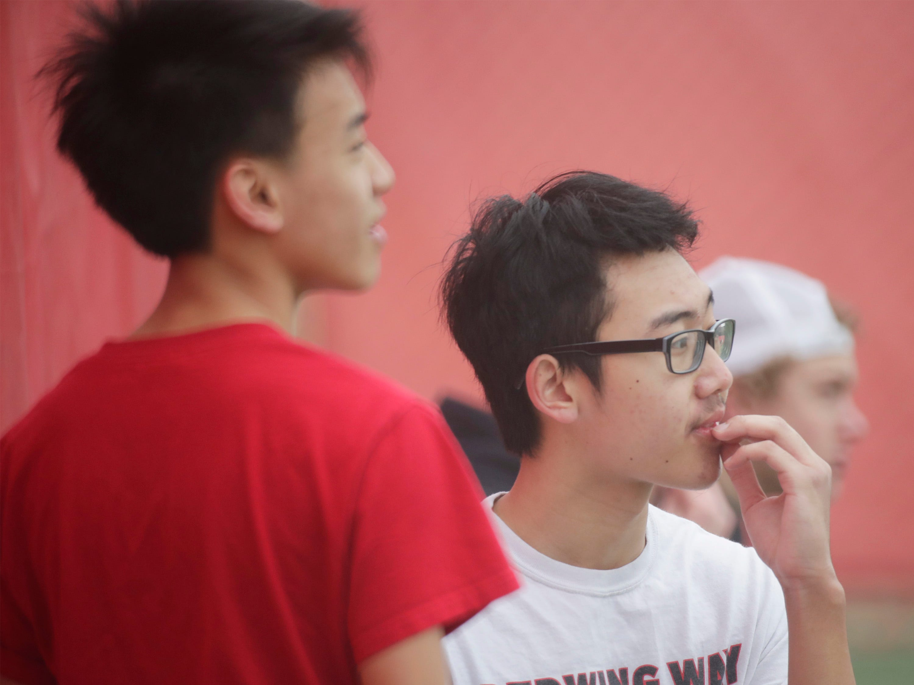 Sheboygan South's No. 1 doubles Kongmeng Yang, left, and Henry Lee analyze the situation against Port Washington between sets, Saturday, April 6, 2019, in Sheboygan, Wis.