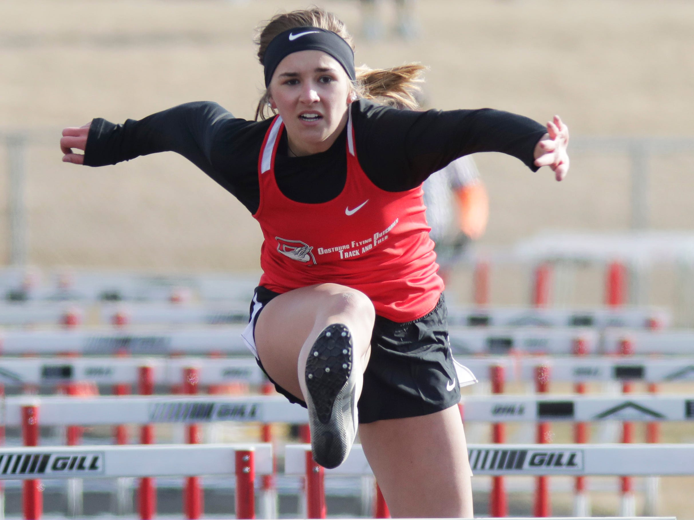 Oostburg's Hailey Gartman clears a high hurdle during the Flying Dutchmen Invite, Friday, April 5, 2019, in Oostburg, Wis.