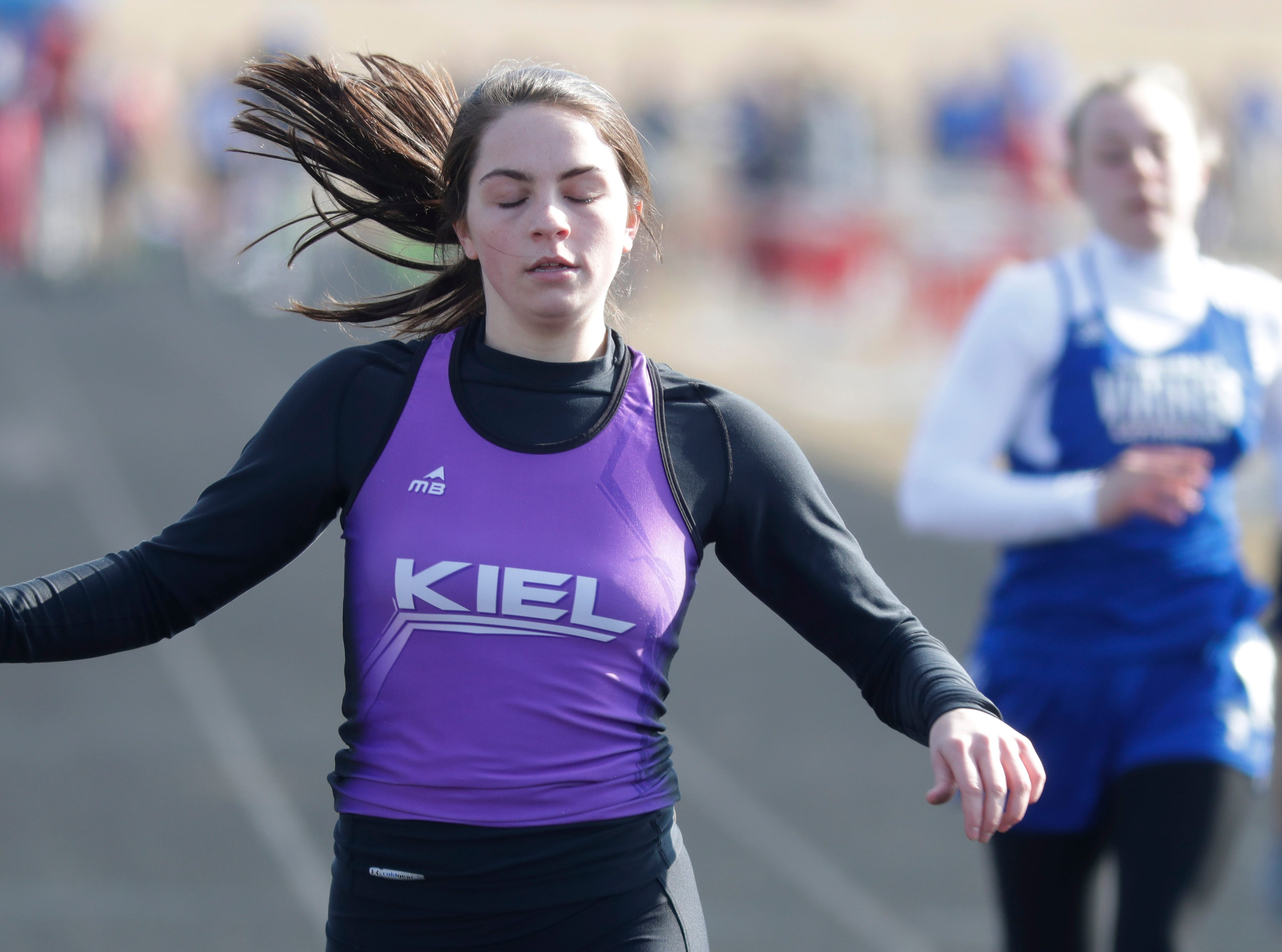 Kiel's Holly Vogel reacts after crossing the finish line in the 100 meter dash, Friday, April 5, 2019, in Oostburg, Wis.