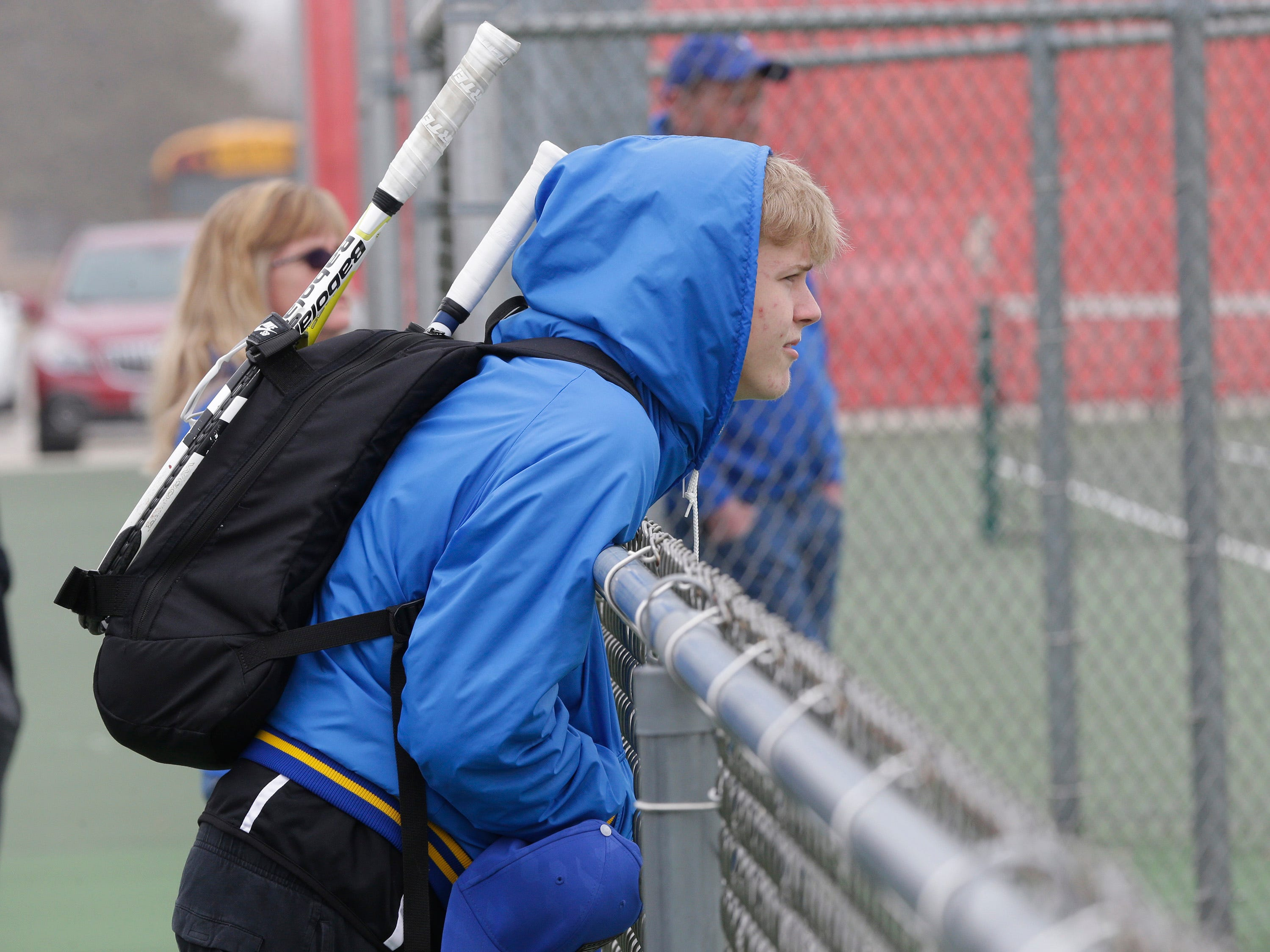 Howards Grove's Austin Paczke watches tennis action before his turn on the courts at Sheboygan South, Saturday, April 6, 2019, in Sheboygan, Wis.