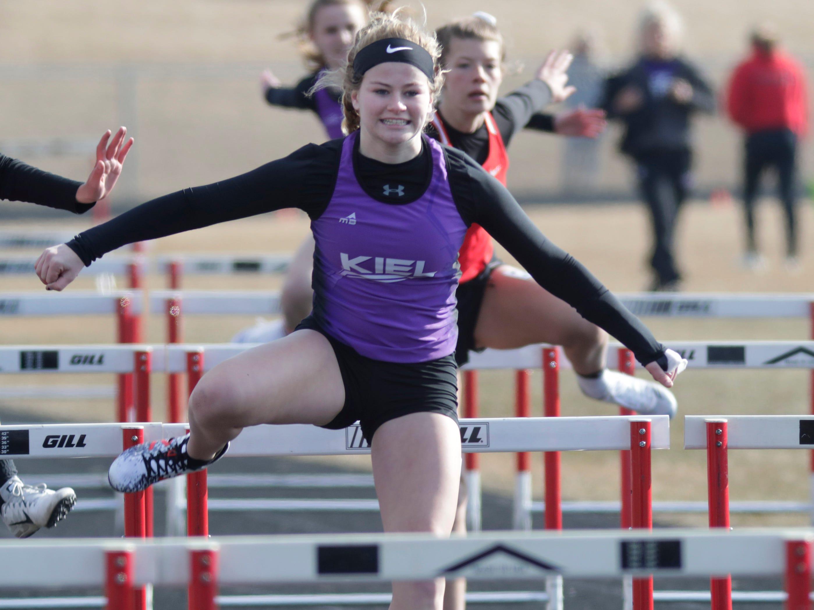 Kiel's Caitlin Kravick runs the 100 meter high hurdles at the Flying Dutchmen Invite, Friday, April 5, 2019, in Oostburg, Wis.