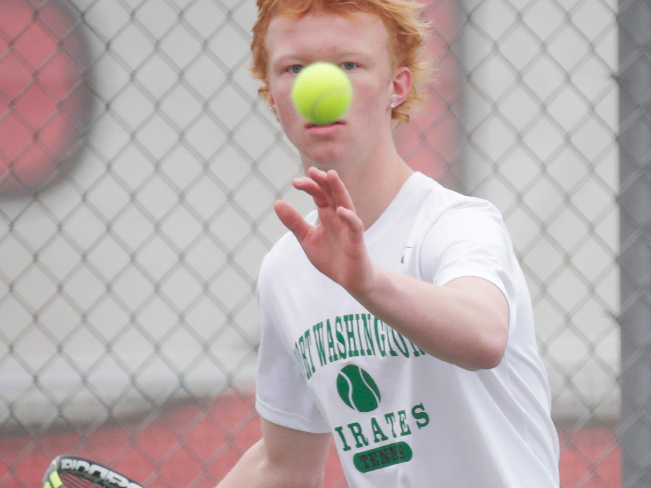 Port Washington's Isaac Welton keeps his eye on the ball during action with Sheboygan South's Nick Larson, Saturday, April 6, 2019, in Sheboygan, Wis.