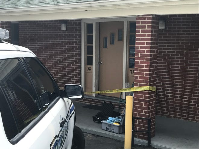 Police said the body of an unidentified woman found at the Royal Inn Motel had signs of trauma.