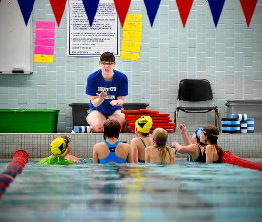 Annika Bordak outlines tasks for young swimmers during Eagles Swim Camp Wednesday, April 3, at Apollo High School in St. Cloud.