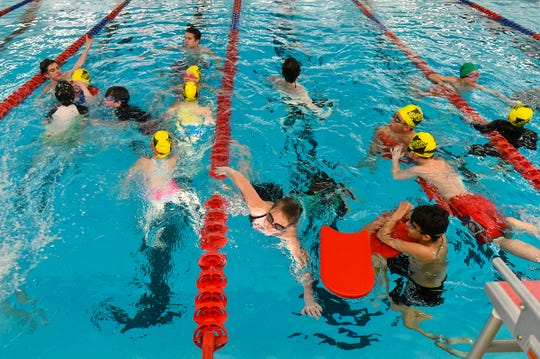 Swimmers gather at the start of Eagles Swim Camp Wednesday, April 3, at Apollo High School in St. Cloud.