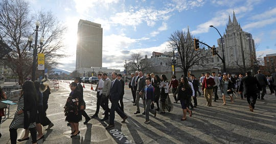 People arrive for The Church of Jesus Christ of Latter-day Saints' two-day conference Saturday, April 6, 2019, in Salt Lake City. Church members are preparing for more changes as they gather in Utah for a twice-yearly conference to hear from the faith's top leaders. (AP Photo/Rick Bowmer)
