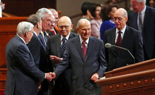 The Church of Jesus Christ of Latter-day Saints President Russell M. Nelson, center, greets the conference of The Church of Jesus Christ of Latter-day Saints Saturday, April 6, 2019, in Salt Lake City. Church members are preparing for more changes as they gather in Utah for a twice-yearly conference to hear from the faith's top leaders. (AP Photo/Rick Bowmer)