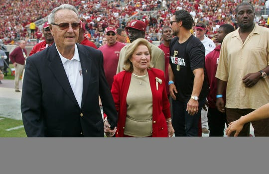 Bobby Bowden and wife Ann great members of FSU's 1993 national title team in 2013 at Doak Campbell Stadium.