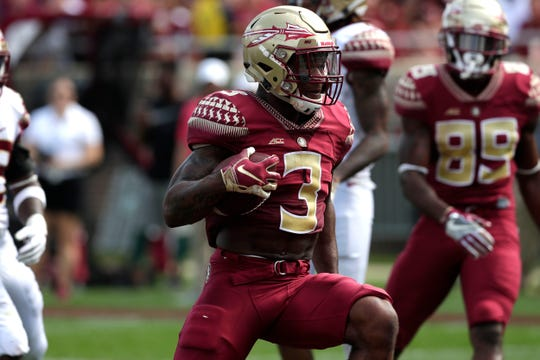 Florida State Seminoles running back Cam Akers (3) runs the ball down the field while dodging defenders. Florida State hosts its Garnet and Gold Spring Game Saturday, April 6, 2019.